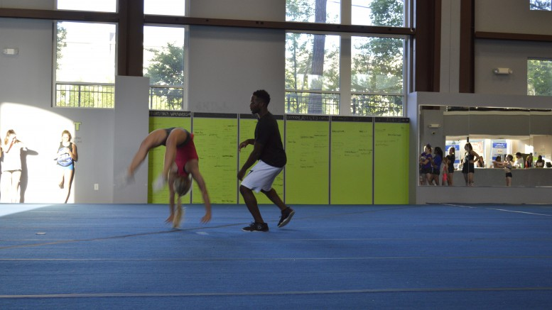 Macia practicing a double-back-handspring full at Carolina Legacy in Cary, NC. One of the more demanding moves to perform, Audrey is working towards gaining the ability to do it unassisted. (Photo Courtesy of Ray Youman)