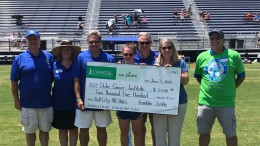 The Bull City All-Star games organizers pose with a $2,500 check that will go towards the Duke Cancer Institute. The inaugural year for the event was a success as the best seniors in the state competed in an iconic venue. (Photo Used by Permission of Lori Campoli)