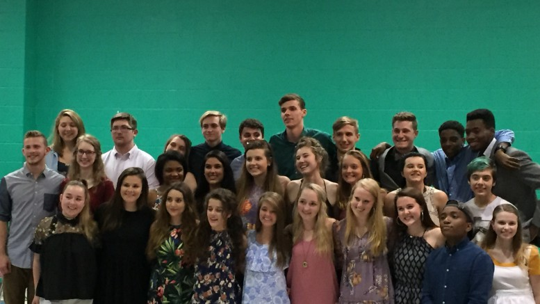During the banquet, seniors gathered on stage to take a final photo together. Afterwards, all active members of the troupe joined for another photo. (Photo courtesy of Isabel Daumen.)