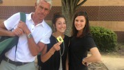 Elise Hall, junior, with Mrs. Cade and Mr. Dinkenor before going off campus. Upperclassmen need to show George Hill, a security guard,  a pass before leaving school. (Photo Courtesy of Chelsea Dinkenor)