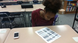 Sierra Hunt views a packet that Susan Ennis passed out with information regarding the Health Occupations Students of America club. The new club held an interest meeting in hopes of encouraging more students to join. (Photo courtesy of Hannah Comeskey)