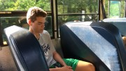 Ryan Welton, varsity soccer player, listening to music and resting before an away game. Athletes mentally prepare themselves on the bus ride to away games to ensure they are focused. (Photo courtesy of Ben Zahavi)