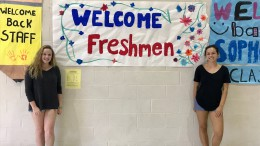 Leesville Liaisons stand by the hand painted signs they made at the beginning of the year to welcome the freshmen. The Liaisons are constantly involved with helping new students feel comfortable at Leesville . (Photo courtesy of Kaitlyn Stocum)