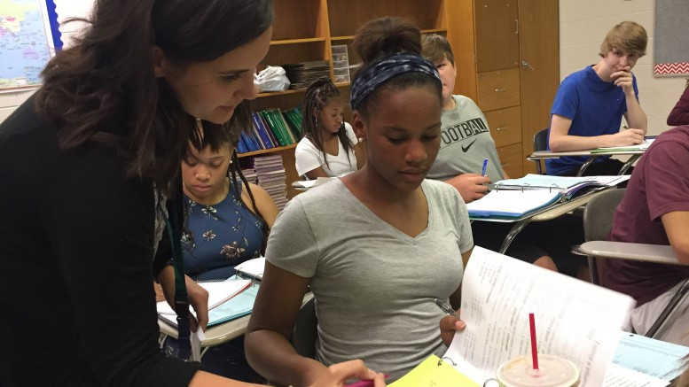 Profesora Richards, a new addition to the Leesville Spanish department, is enthusiastic about joining the Pride. As she grades homework for the day, the students are chatting to her in Spanish about their plans for the weekend. (Photo used by permission of Isabel Daumen)