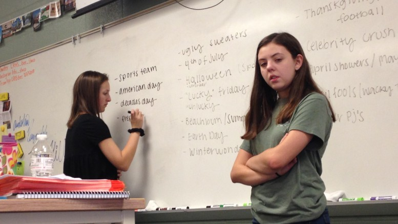 Taylor Hill (right), senior and Leesville Executive Council President, and Erika Nelson (left), senior and one of the Executive Council's Vice Presidents, led the brainstorming session for the themes of the individual days during Homecoming Week.  Many members of the Council contributed their ideas, and the Council narrowed down the options through voting. (Photo courtesy of Sydney Tucker)