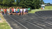 The Leesville Road High cross country team talking before a practice. Cross country athletes have been training for eight weeks now, four of which were during the summer. (Photo courtesy of Jacob Polansky)