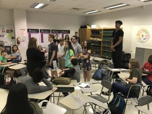 Hailie Silberman, senior, explains her family sculpture to her fourth period Speech I class. By explaining her family situation and relationship to family members, she grows closer to her classmates. (Photo courtesy of Erin Darnell)