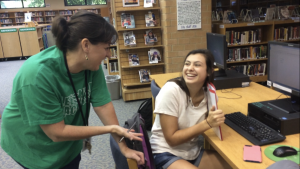 Amy Wedge laughs with Caroline Muma, now a Leesville alumni, after discussing a project. Muma was in Wedge's upperclassman Speech I class last school year. (Photo courtesy of Erin Darnell)
