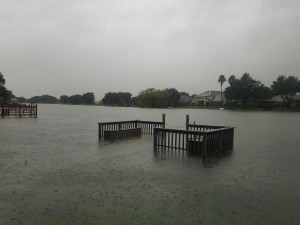 The lake in Thai's neighborhood affected by 40 inches of rain. Usually, these decks are used to harbor small boats and kayaks. Many of these boats were swept away because of the flooding. (Photos used by permission of Kelly Thai)