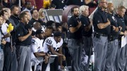 """Members of the Oakland Raiders kneel together during the national anthem. The sports world has recently gained lots of attention due to the protests during """"The Star-Spangled Banner"""" at professional sporting events. (Photo courtesy of commons.wikipedia.com)"""