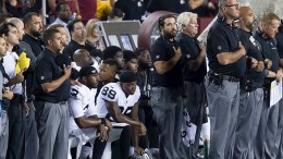 "Members of the Oakland Raiders kneel together during the national anthem. The sports world has recently gained lots of attention due to the protests during ""The Star-Spangled Banner"" at professional sporting events. (Photo courtesy of commons.wikipedia.com)"