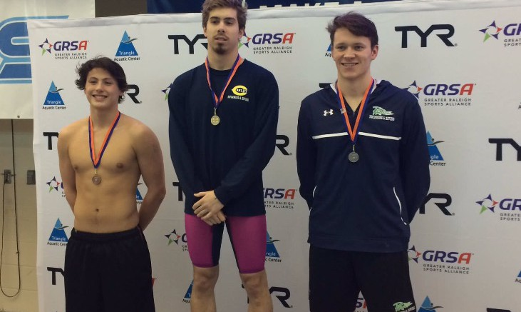 Jacob Phillips, a former Leesville swimmer, standing to take his hard earned third place medal at a meet. Leesville Swim team is known for the many first place finishes taken by the girls, and the boys' relay race pushing the team to victory. (Photo used by permission of Jack Rodgers)
