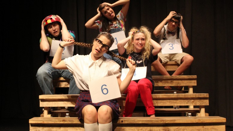 A few cast members sing a part during 'The 25th Annual Putnam County Spelling Bee'. The musical had a much smaller cast than usual, featuring only nine cast members. (Photo used by permission of Katrina Tarson)