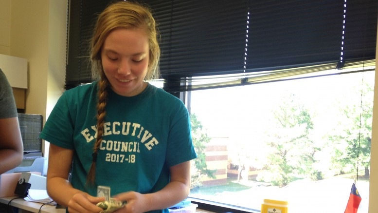 Reese Layh, Leesville sophomore and Executive Council member, counts money during SMART Lunch that students in Executive Council collected from first period classes at Leesville Road High School.  The Executive Council will donate the money to the Juvenile Diabetes Research Foundation (JDRF), which will then use the money to help researchers find a cure for Type One diabetes.  (Photo courtesy of Sydney Tucker)