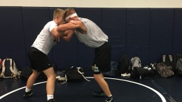 Varsity wrestlers Brandon Jones (left) and Adam Aldridge (right) training in Leesville Road High's mat room during a preseason workout. The Leesville wrestling team has been holding preseason workouts since mid July. (Photo courtesy of Jacob Polansky)