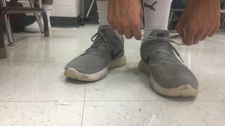 Tying your right shoe before your left shoe is a common superstition among athletes in any sport. Superstitions are everywhere, and many people believe in them and their effects.  (Photo courtesy by Chelsea Dinkenor)
