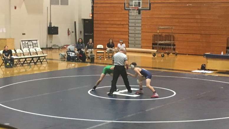 Max Buico and Richie Rizzuto, two sophomores at Leesville, shaking hands before their match, on November 9, 2017. There were twelve total matches wrestled. (Photo courtesy of Matt Wiener)