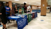 Elizabeth City State University, Greensboro College, Guilford College, and Johnson & Wales University representatives/ alumni set up their booths at Leesville's college fair in the cafeteria. Colleges that attended the fair handed out information slips, pencils, or stickers for their school.  (Photo Courtesy of Hannah Comeskey)