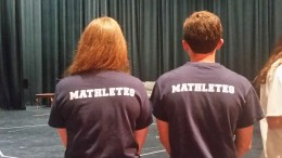 "Club officers of MNHS pose wearing their ""Mathletes"" shirts. The club is nationally known as Mu Alpha Theta (Photo courtesy of Hannah Comeskey)"