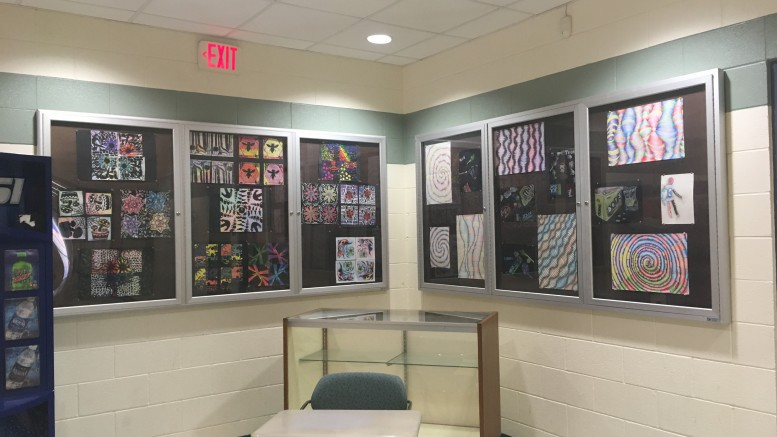 Jessica Emanuel, sophomore, Alana Huntwork, junior, and Katherine Eaton, junior,  each recently created art pieces  in intermediate art class, which are displayed in the Murphy building. Each student created their different pieces for very different purposes. (Photo courtesy of Jayla Corbett)