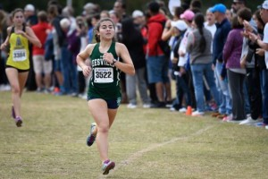 Comesky competed in the NCHSAA 4A Mideast regional meet. She helped her team qualify for States by running a strong race. Photo used by permission of Dan Loughlin.