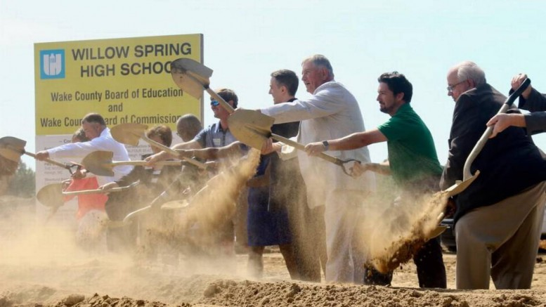 Wake County officials break ground on June 29, 2017 at the construction site of Willow Spring High School. The school will house overflow students to meet House Bill 13 passed by the North Carolina Senate. (Photo used by permission of The News and Observer)