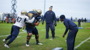 Robert B. Green, an outside linebacker coach, coaches his players the correct way to tackle. Green not only focuses on the safety of his players, but also the helps them build their leadership and administrative skills to take action when a teammate gets hurt. (Photo used by permission of The News and Observer)