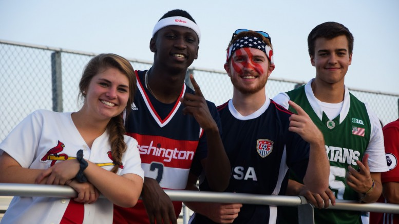 """Sidney Credle, second from right, poses with friends during an """"America Out"""" themed football game against Garner. Credle hopes to follow in his brother's footsteps and gain acceptance into the prestigious United States Naval Academy. (Photo used by permission of Emma Shepperd)"""