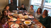 The Polansky and Macri families sit down to Thanksgiving dinner. The Macri's made the twelve hour drive from Florida to North Carolina to share a meal and give thanks. (Photo used by permission of Domenick Macri)