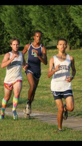 Carson Ellerby (center) races in a cross country meet as a member of the Leesville cross country team. Ellerby first started running in sixth grade when he participated in the Raleigh RunDown Downhill Mile. (Photo used by permission of Carson Ellerby)