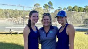 Helen Alvis, left, and Kylie Rigsby, right, celebrate after their doubles win in the second round of the 4A East Regional in Wilmington. The Pride duo qualified for state championship tournament, advancing to the semifinals. (Photo used by permission of Casey Bombien)