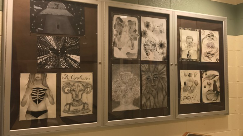 The Visual Arts class' most recent project involved drawing personal photos in black and white using techniques like shading. Each student's' art was specific to their own personal interests. (Photo courtesy of Kaitlyn Stocum)