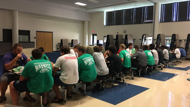 In the above image the football team enjoys a pregame meal in the multipurpose room. Thanks to the football families the entire team and coaching staff get a good meal every football friday. (photo used by permission of Sarah Peterson)