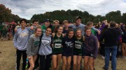 Pictured with her fellow teammates, Audrey Hemming, senior, has a big smile after running a successful race. The team takes on states this Saturday, November 4, and hope for a fifth place ranking. (Photo used by permission of Audrey Hemming)