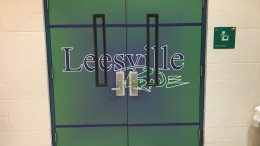 In the above image is the spectator entrance to the LRHS main gym. The doors are wrapped with a vinyl material that makes the Leesville Pride name pop (photo courtesy of Lucy Leen)