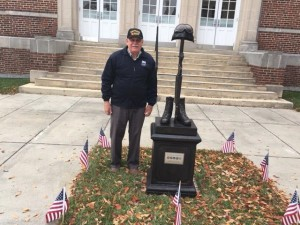 Hoffman stands beside the Vietnam War memorial, located outside the Clayton town center. (Photo courtesy of Matt Wiener).