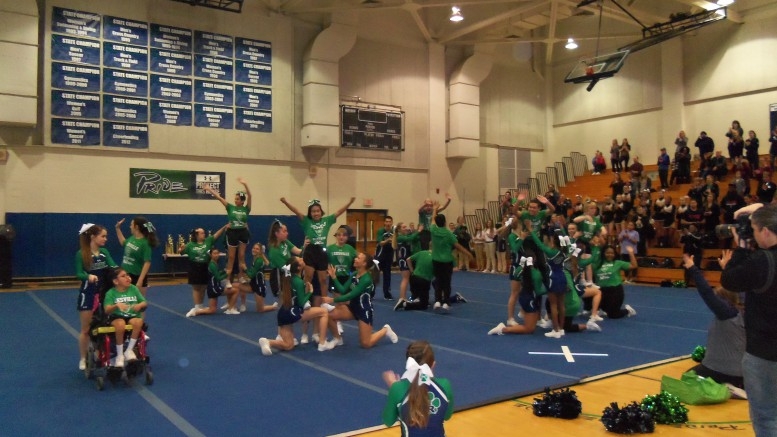The Heart of the Pride special needs cheer team practices their routine with the varsity cheer team leaders. The program has now been in place for two years. (Photo used by permission of Christine Killela)
