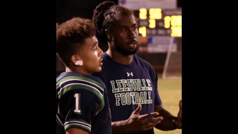 Coach Rackley gives advice to one of his athletes on the sidelines during a football game. Since Rackley joined Leesville at the start of this school year, he has become an important asset to the athletic and school community. (Photo used by permission of Ranier Rackley)