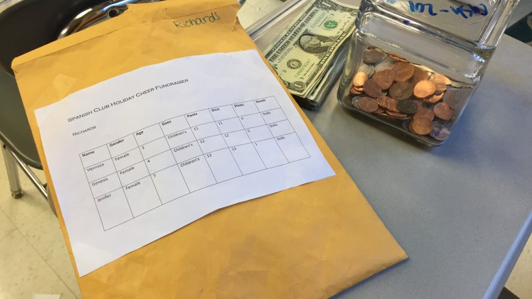 Donations for the Adopt a Family Fundraiser ended Friday, December 1. After collecting all the donations from the various classes, Spanish club officers total up the money raised. Photo courtesy of Isabel Daumen.