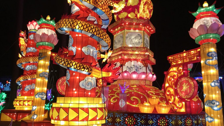 Many of the lantern displays feature classic Chinese symbols and colors. This year, the attraction introduced spinning parts and flashing lights, making the exhibition even more appealing and attention-grabbing. (Photo courtesy of Natalie Gore)