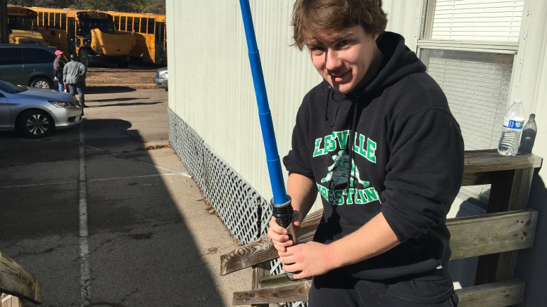 Daniel Mosakewicz, a Leesville senior, poses with a lightsaber hours before the opening of The Last Jedi. Many fans went to the premiere in costume, brought props, and even engaged in lightsaber duels. (Photo Courtesy of Jacob Polansky)