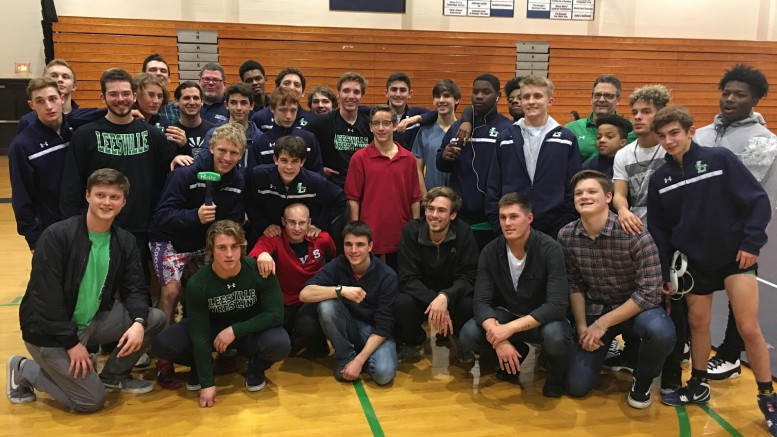 The entire wrestling team stopped for a quick photograph before their tri-meet against two Cap 7 teams, on December 21. Even head coach, Jason Wyss, hopped in the back!  Photo used with permission from Max Buico.